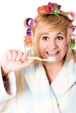 Funny housewife with curlers and toothbrush Royalty Free Stock Images
