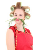 Funny housewife with hair curlers and dill mustache Stock Image