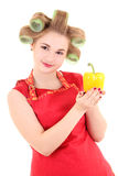 Funny housewife with hair curlers and yellow pepper Royalty Free Stock Photo