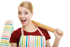 Funny housewife in kitchen apron holds baking rolling pin Royalty Free Stock Image