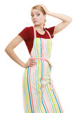 Funny housewife in kitchen apron Royalty Free Stock Photography