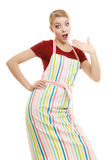 Funny housewife in kitchen apron stock images