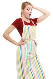 Funny housewife in kitchen apron stock image