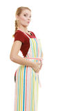 Funny housewife in kitchen apron stock photography