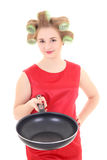 Funny housewife with pan and hair curlers Royalty Free Stock Photography