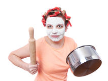 Funny housewife with roller-pin and pan Royalty Free Stock Photography