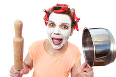 Funny housewife with roller-pin and pan Stock Photo