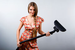 Funny housewife with vacuum cleaner Stock Images
