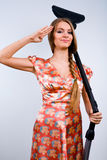 Funny housewife with vacuum cleaner Royalty Free Stock Image