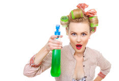 Funny housewife / woman spraying the cleaner Royalty Free Stock Images