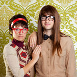Funny humor nerd couple on vintage wallpaper Royalty Free Stock Photo