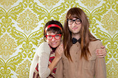 Funny humor nerd couple on vintage wallpaper. Funny humor silly nerd couple on retro vintage wallpaper background stock images