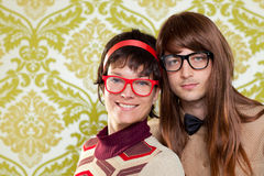 Funny humor nerd couple on vintage wallpaper. Funny humor silly nerd couple on retro vintage wallpaper background Royalty Free Stock Photography