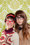 Funny humor nerd couple on vintage wallpaper Stock Photo