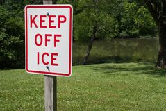 Keep off the ice 4465. Funny and humorous warning sign illustrating a miscommunication and mixed message stock image