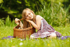 Funny hungry little girl having picnic in park Royalty Free Stock Photos