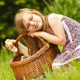 Funny hungry little girl having picnic in park Royalty Free Stock Photo