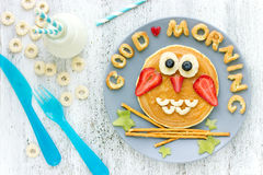 Funny idea for kids breakfast owl pancakes. With fruits and berries stock photo