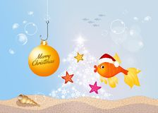 Red fish at Christmas. Funny illustration of red fish at Christmas in the ocean Royalty Free Stock Photo