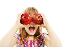 Funny image of little girl showing apples Stock Photography