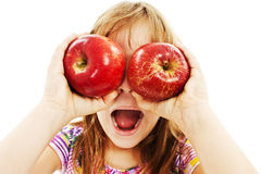 Funny image of little girl showing apples Royalty Free Stock Image