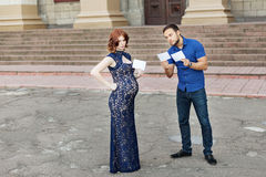 Funny image. Сouple expecting a baby: they holds a signs Royalty Free Stock Photos