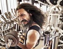 Funny image of a skinny bodybuilder Stock Image