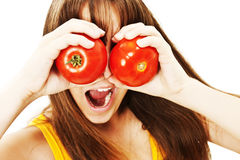 Funny image of woman showing tomatoes. Royalty Free Stock Image