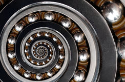 Funny incredible unrealistic industrial Ball Bearing spiral abstract pattern background. Spiral machinery abstract fractal pattern. Background. Spiral Stock Images