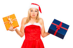 Funny indecisive Santa female with Christmas gifts Royalty Free Stock Photos