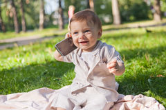 Funny infant baby boy with mobile phone Stock Photography