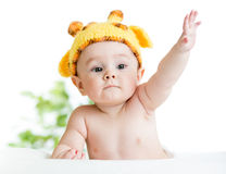 Funny infant baby dressed in hat. Funny infant baby boy in hat Royalty Free Stock Image