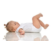 Funny Infant child baby girl in diaper lying on a back and looki Stock Photos