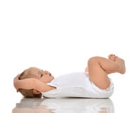Funny Infant child baby girl in diaper lying on a back and looki Stock Photo