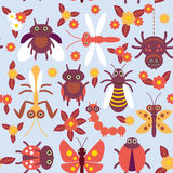 Funny insects Spider butterfly caterpillar dragonfly mantis beetle wasp ladybugs seamless pattern on blue background with flowers. And leaves. Vector Royalty Free Stock Photo