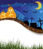 Funny Jack o lanterns on a cemetery Stock Image
