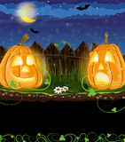 Funny Jack o Lanterns. Opposite each other near the fence. Halloween night scene royalty free illustration