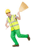 Funny janitor with broom Stock Images