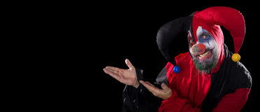 Funny Jester showing to copyspace, concept halloween and horror Royalty Free Stock Photo
