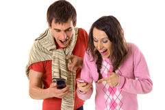 Funny joke in mobile. Happy man and woman pointing at mobile Stock Image