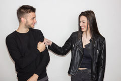 funny joking punching fist woman man couple, sister brother, 20s stock photography
