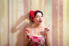 Funny joyful beautiful pinup lady with paint Royalty Free Stock Photography