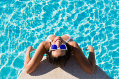 Funny joyful woman on summer vacation in swimming pool Royalty Free Stock Photo