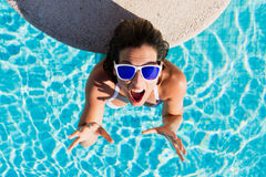 Funny joyful woman on summer vacation in swimming pool Stock Image