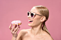 Funny joyful woman with sweets Royalty Free Stock Photography
