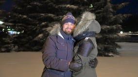 Funny Joyful Young couple. Girl kissing young joyful man. Happy Valentines Day. stock footage