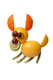 Funny jumping dog made of fruits. On isolated background Royalty Free Stock Photos