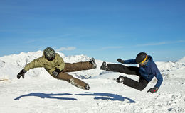 Funny jumping guys in winter mountains Royalty Free Stock Images
