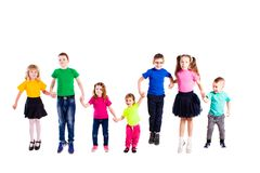 Funny jumping kids isolated. Funny jumping kids holding hands isolated on white Royalty Free Stock Photos