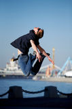Funny jumping young man royalty free stock photography